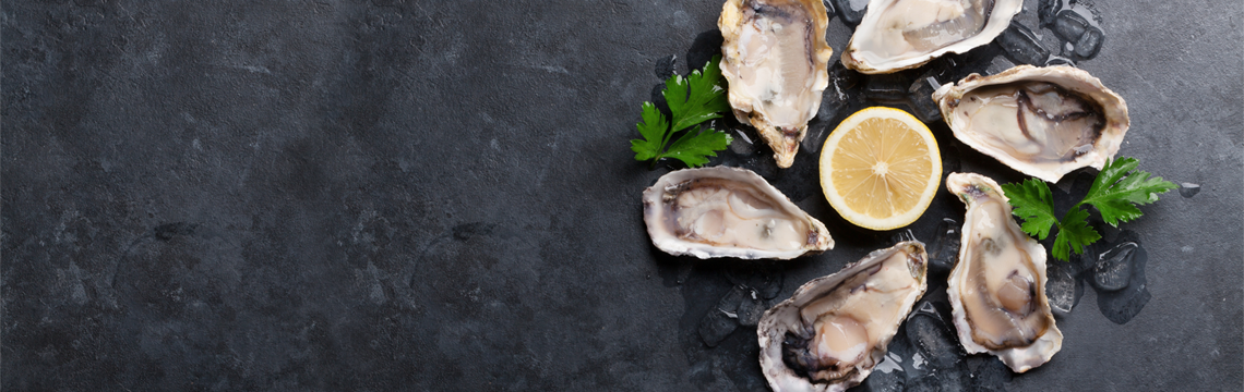 Freshly shuckled oysters with a squeeze of fresh lemon image