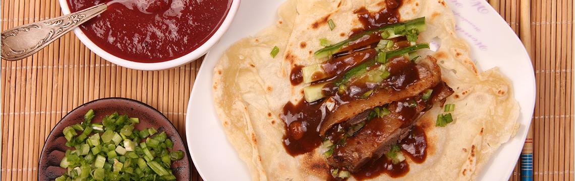 Crispy five spice scented, Peking Duck pancakes, hoisin sauce, Asian greens. image