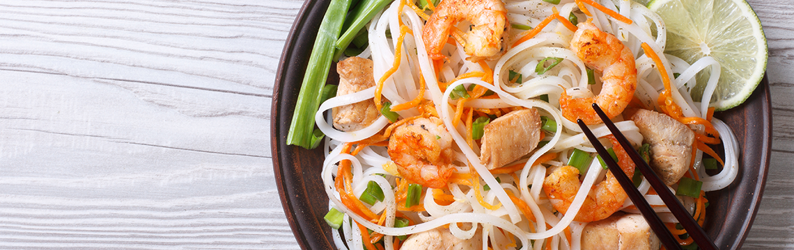Spicy Thai chicken salad with vermicelli, fresh mint and coriander. image